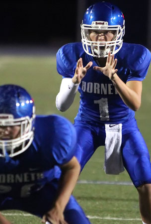 Quarterback Jake Meaders sets to take a snap. (Photo by Rick Nation)