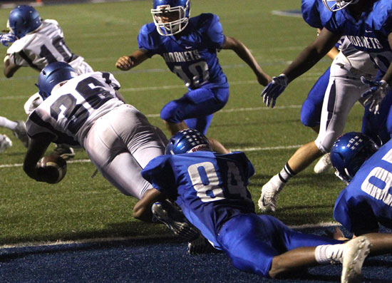 Catrell Wallace (84) nearly hauls down Conway Blue running back Trevor Marshall (36) for a safety. (Photo by Rick Nation)