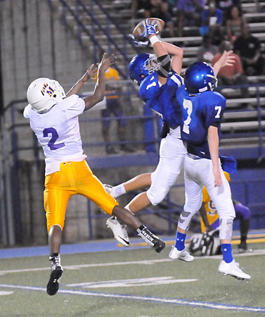 Austin Ledbetter intercepts a pass as teammate Aidan Adams (7) tries for it too in front of Horace Mann's Keith Green Jr. (Photo by Kevin Nagle)