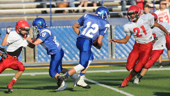 Noah Davis (28) springs loose teammate Hayden Schrader (12). (Photo by Kevin Nagle)