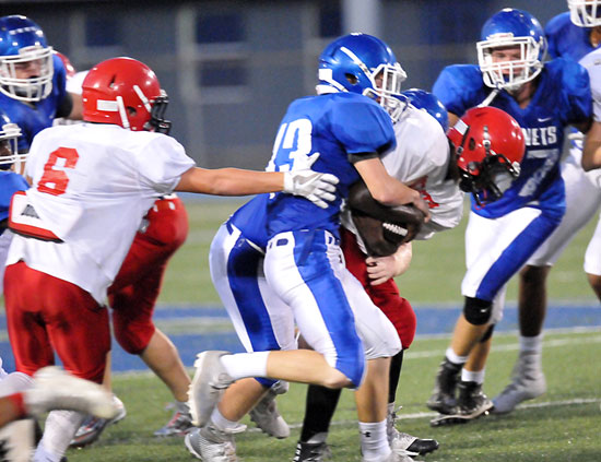 Tristan Sehika (43) leads the charge on a tackle. (Photo by Kevin Nagle)