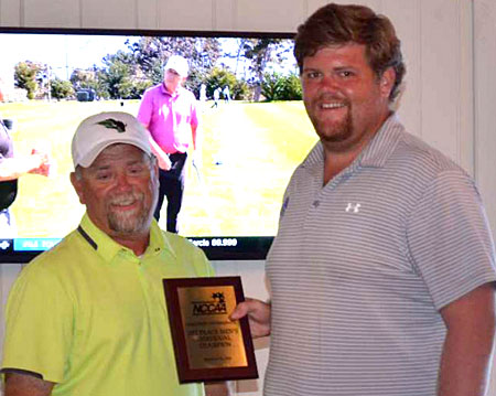 Bryant High School alum Austin Harmon, right, is awarded the individual medalist trophy at the NCCAA Central Regional Golf Tournament. (Photo courtesy of Darryl McPhate, CBC)