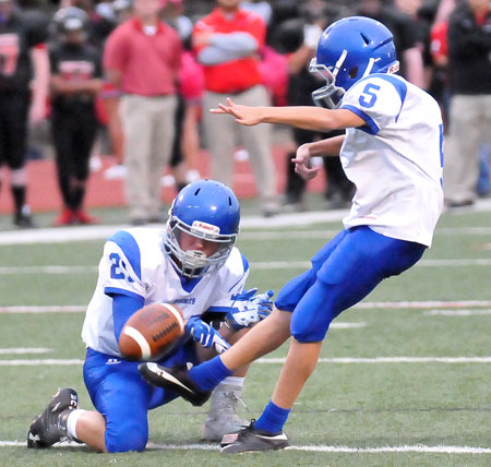 Brock Funk attempts an extra point out of the hold of Hart Penfield. (Photo by Kevin Nagle)