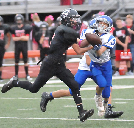 Ryan Riggs (3) breaks up a Russellville pass play. (Photo by Kevin Nagle)