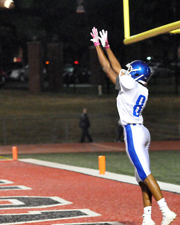 Catrell Wallace leaps to haul in a pass for a two-point conversion. (Photo by Kevin Nagle)