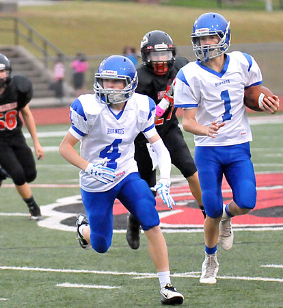 River Gregory (4) leads the way for Garrett Wilson (1). (Photo by Kevin Nagle)