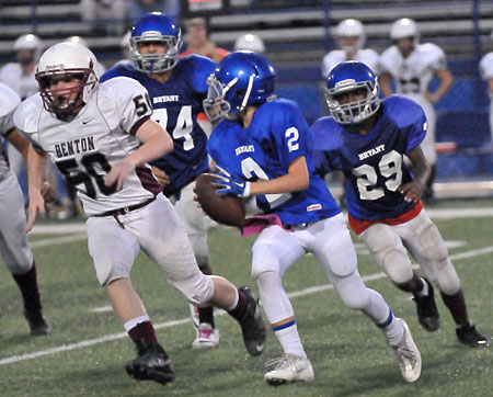 Trey Williams sprints upfield after blocks by Carlos Albarran (74) and Arthur Woods (29). (Photo by Kevin Nagle)