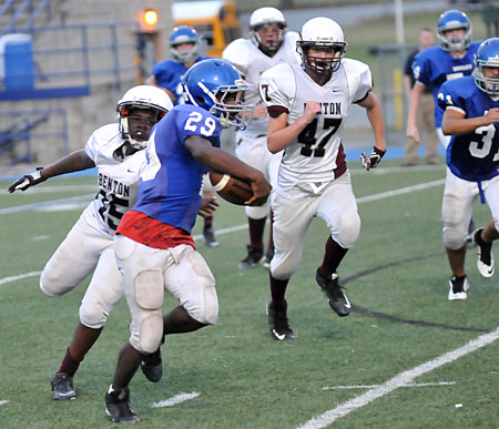 Arthur Woods (29) slips a tackle as he turns the corner. (Photo by Kevin Nagle)