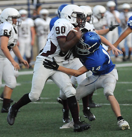 Devyn Spurgeon makes a tackle. (Photo by Kevin Nagle)