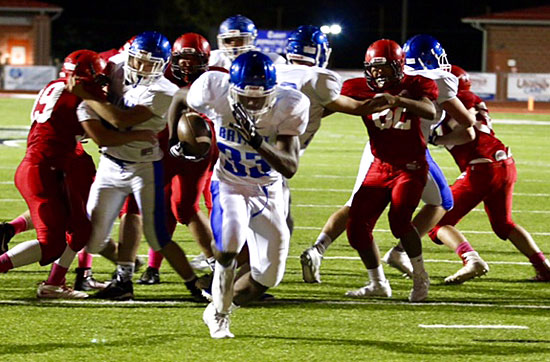 Ahmad Adams breaks free on one of his two touchdown runs. (Photo by Jon Staton)