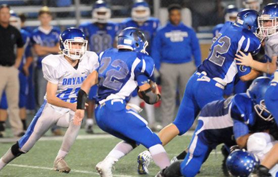 Tristan Sehika (43) closes in on Conway White running back Luke Bailey. (Photo by Kevin Nagle)