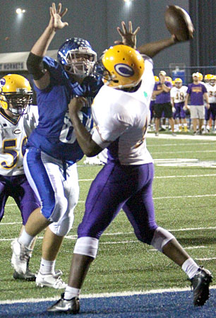 David Shifflet pressures the quarterback. (Photo by Rick Nation)