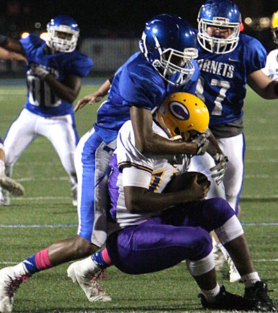 Catrell Wallace buries a ball carrier as Brantley Thomas arrives to help. (Photo by Rick Nation)