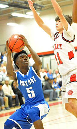 Keith Merriweather Jr. (5) pump fakes a Searcy defender into the air. (Photo by Kevin Nagle)