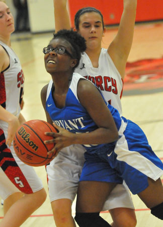 Sierra Trotter looks for room to shoot. (Photo by Kevin Nagle)