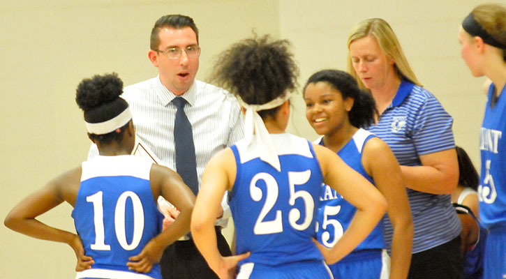 Head coach Nathan Castaldi and assistant DeAnna Ward talk strategy during a timeout. (Photo by Kevin Nagle)