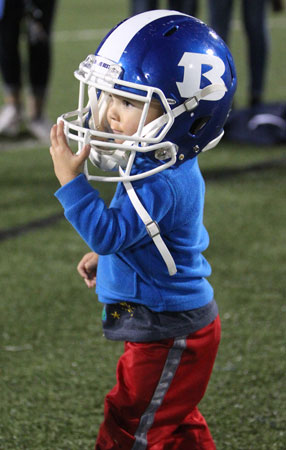 A future Hornet tries on a helmet after Friday's game. (Photo by Rick Nation)