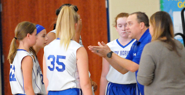 Bethel coach Derek McGrew instructs the Lady Hornets during a timeout. (Photo by Kevin Nagle)