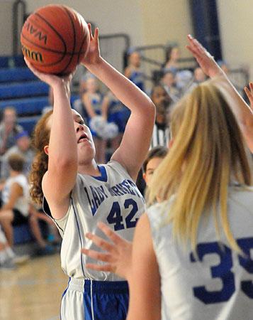 Taryn Keim eyes the basket. (Photo by Kevin Nagle)