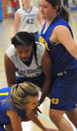 Bethel's Jade Rivers fights for a loose ball. (Photo by Kevin Nagle)