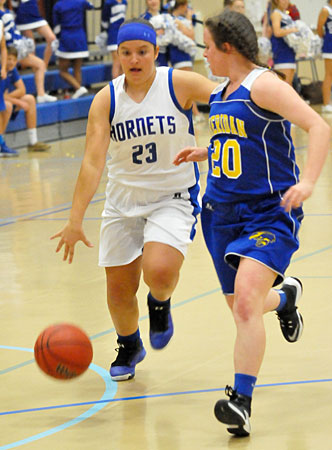 Bethel's Addison Funk drives up the court. (Photo by Kevin Nagle)
