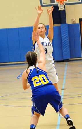 Baylee Hutchison fires a jumper from near the top of the key. (Photo by Kevin Nagle)