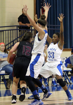 Bryant's McKenzie Muse and Tyianna Robinson trap a Benton ball-handler. (Photo by Rick Nation)