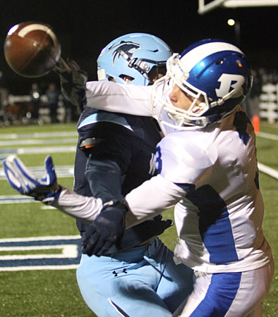 Reece Coates reaches back through a Har-Ber defender to make a circus catch. (Photo by Rick Nation)