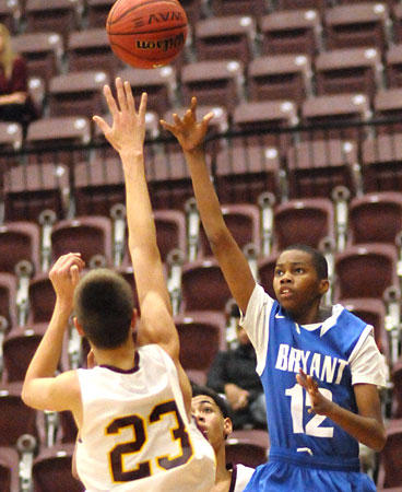 Keyshawn Scott tosses up a jumper. (Photo by Kevin Nagle)