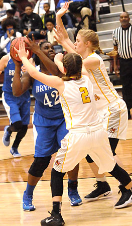 Mekeycia Baker looks for room for a shot against a double-team. (Photo by Kevin Nagle)