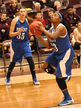 Tyianna Robinson drives past Lake Hamilton's Meg Harrison as teammate McKenzie Muse (35) spots up outside. (Photo by Kevin Nagle)