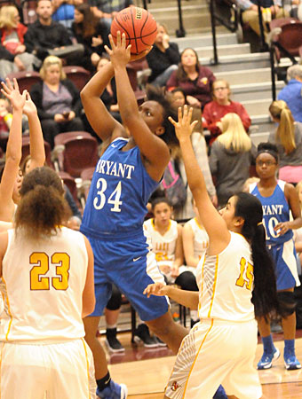 Bryant's Ivory Russ attacks the basket. (Photo by Kevin Nagle)