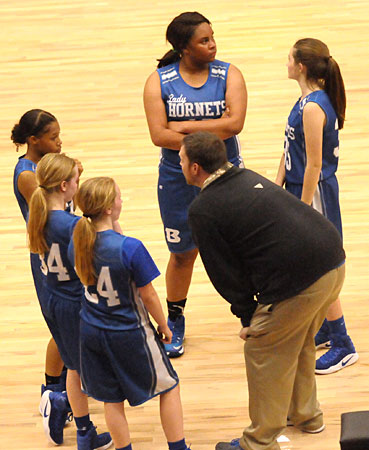 Bryant White coach Ben Perry instructs his players during a timeout Monday night. (Photo by Kevin Nagle)