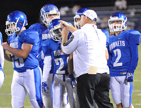 Bryant defensive coach John Orr instructs during a timeout on Tuesday. (Photo by Kevin Nagle)