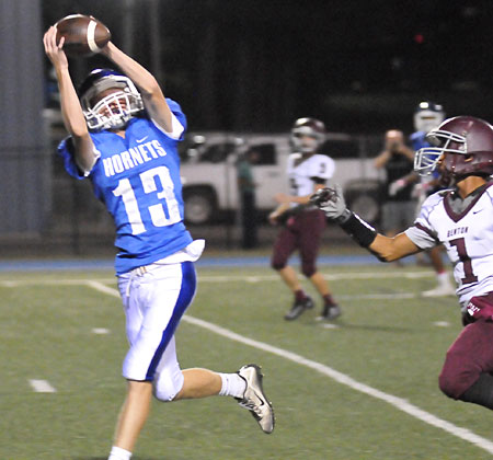 Gage Stark reaches up to haul in a touchdown pass. (Photo by Kevin Nagle)