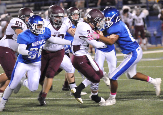 A pair of Bryant defenders including Austin Bailey (80) descend on Benton quarterback Peyton Hudgins. (Photo by Rick Nation)