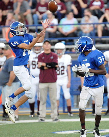 Devyn Spurgeon (14) leaps up to field an onside kick as teammate La'Quav Brumfield (35) looks back. (Photo by Kevin Nagle)