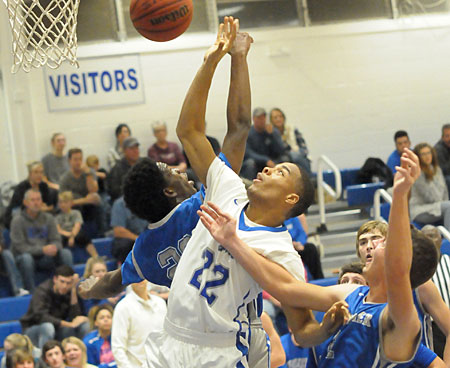 Deron Canada (22) unleashes a shot in traffic. (Photo by Kevin Nagle)