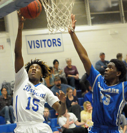 Rodney Lambert gets a shot up past Greenbrier's Deondre Smith. (Photo by Kevin Nagle)